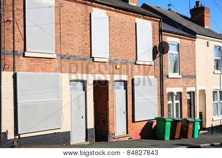 Boarded up terrace house