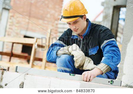 construction mason worker bricklayer working level levelling bricks
