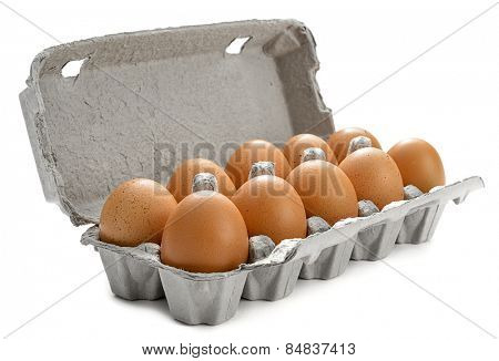 Cardboard egg box with ten brown eggs isolated on white background.