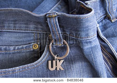 Faded jeans with a UK key ring on belt loop