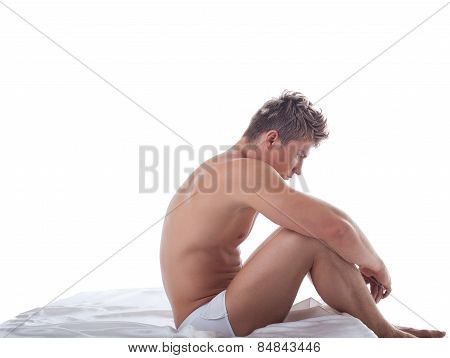 Concept of impotence. Upset man sitting in bed