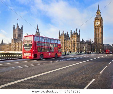 LONDON - DEC 21: Iconic London bus crossing Westminster Bridge in the United Kingdom December 21, 2009 in London, England