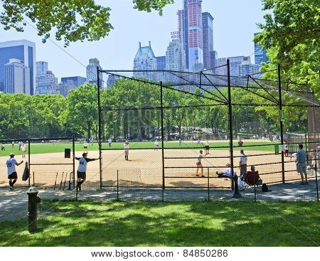 New York, NY, USA - JUNE 28:  Baseball players in Central Park playing on one of the 26 ballfields in the summer on June 28th, 2012 in New York