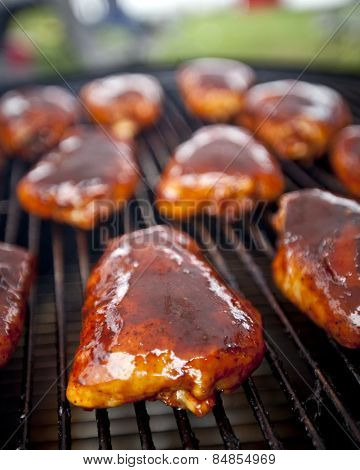 BBQ chicken thighs on a smoker
