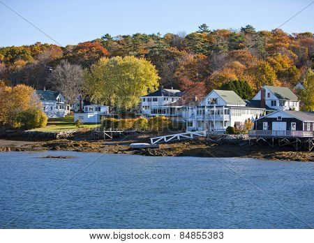 Beautiful New England colonial style homes on the water in fall