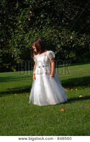 Flower girl under apple tree