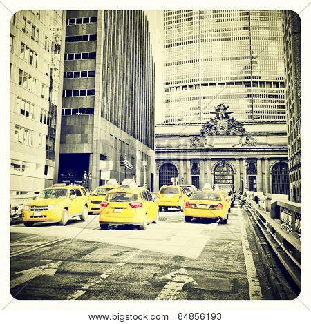 Yellow cabs on Park Avenue in front of Grand Central Terminal, New York with Instagram effect filter poster