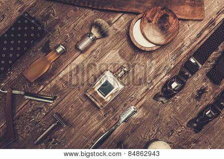 Gentleman's accessories on a on a luxury wooden board  poster