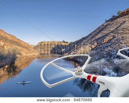 quadcopter drone flying over lake with a canoe - Horsetooth Reservoir near Fort Collins, Colorado