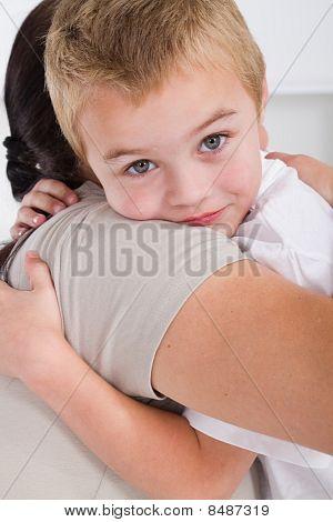 little boy hugging mother