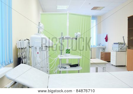 The image of an empty treatment room. Magnetic therapy device