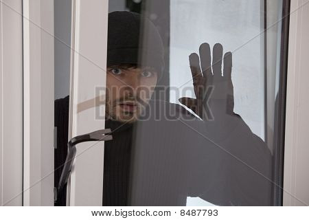 Burglar Looking Into The Window
