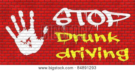 stop drunk driving, don't drink and drive with an alcohol intoxication. Prevention against irresponsible driver. graffiti on red brick wall, text and hand