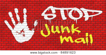 stop junk mail and spam graffiti on red brick wall, text and hand