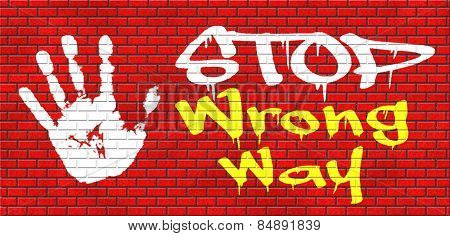 wrong way stop and take a uturn making a mistake turn back now bad direction graffiti on red brick wall, text and hand