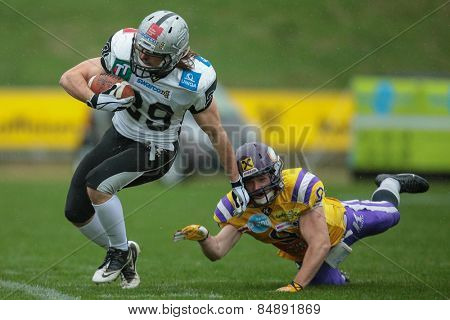 VIENNA, AUSTRIA - MARCH 23, 2014: RB Andreas Hofbauer (#29 Raiders) runs with the ball in an AFL football game.