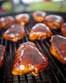 BBQ chicken thighs on a smoker  poster