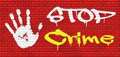 stop crime stopping criminals by neighborhood watch or police force fight criminal behavior stopping violence and arrest offenders or just by prevention graffiti on red brick wall, text and hand poster
