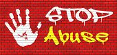 stop abuse child protection prevention from domestic violence and neglection end abusing children graffiti on red brick wall, text and hand poster