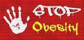 obesity prevention stop over weight start campaign with low fat diet for obese children and adults with eating disorder graffiti on red brick wall, text and hand poster