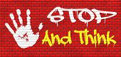 stop and think meking a wise decision sleep it over and use your brain graffiti on red brick wall, text and hand poster