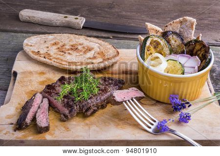 Provencal Style Horse Meat Entrecote Steak With Ratatouille And Flat Bread.