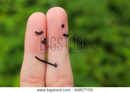 Finger art of a Happy couple. Girl a hug and kisses the boy.