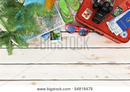 Travel Concept. Sunbed,  World Map, Beach Shoes, Sunscreen, Passport, Air Tickets,camera,