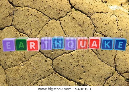 Earthquake In Toy Block Letters