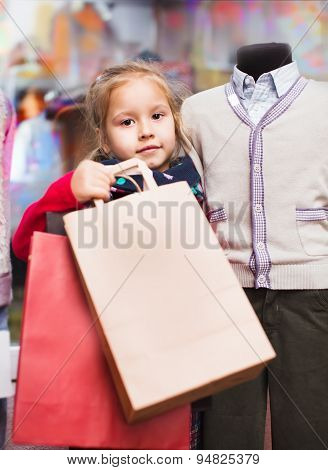 portrait of cute little girl with shopping bags
