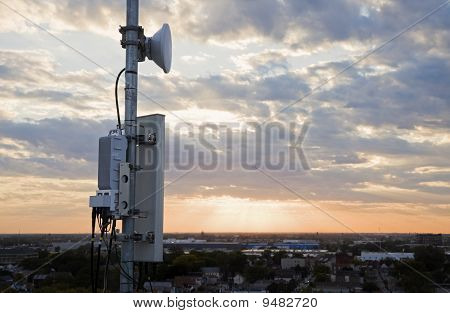 Cellular antenna mounted on the pole at sunset poster