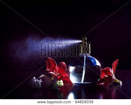 Pink Bottle Of Perfume Spraying