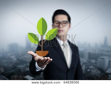 Illustration Plant Stems In Business Man Hand, New Business In The City Collection, Studio Shot