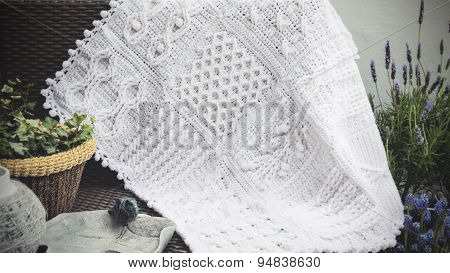 Crochet, Cable Knit Afghan Baby Blanket in White on Sofa with Lavender