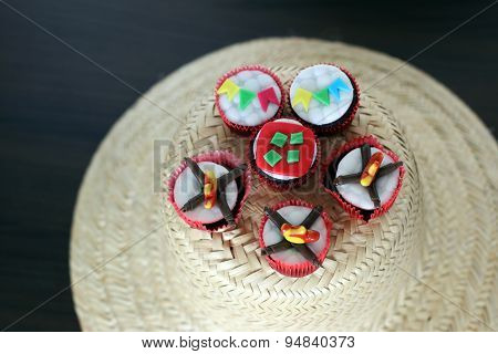Cupcakes decorated for celebrating St John  in Brazil served on traditional hay hat