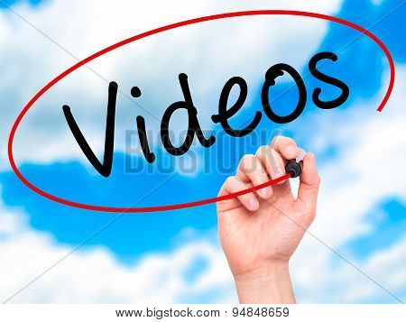 Man Hand writing Videos with black marker on visual screen.