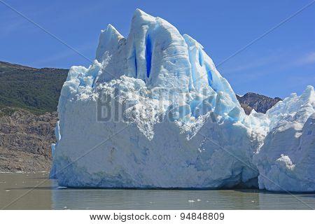 Iceberg At The Edge Of A Glacier