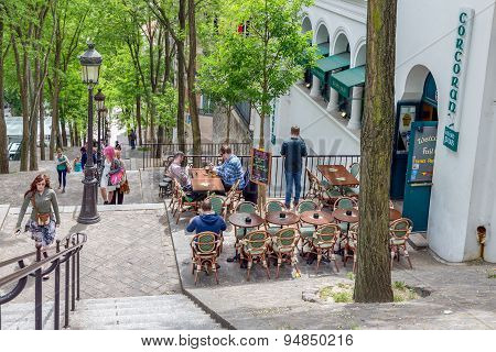 Tourists Climbing Stairs With Irish Pub Near Montmartre, Paris