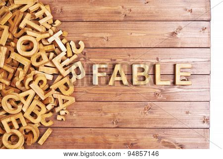 Word fable made with wooden letters
