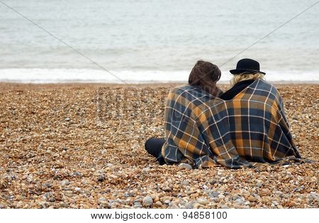 Friends sitting on the beach