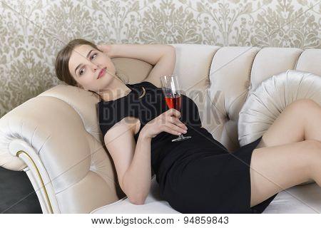 Nostalgic Woman Relaxing On Sofa