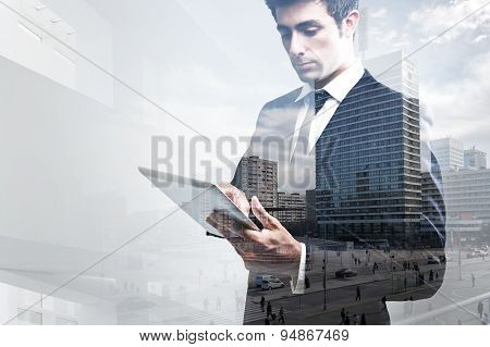 Double Exposure Of Young Businessman Using Digital Tablet