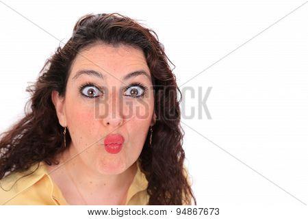 Headshot Of A Spanish Woman Throwing A Kiss