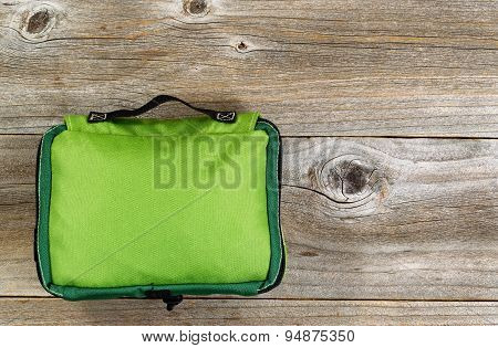 First Aid Medical Bag On Rustic Wooden Boards