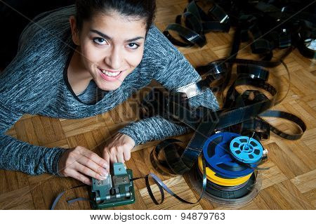Young Woman Editing 8 Mm Movie Reel Film