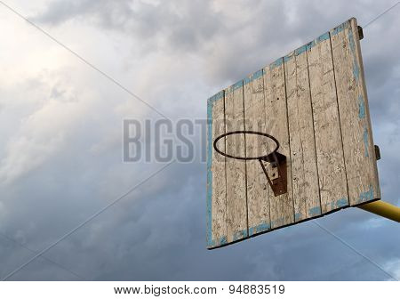 Wooden Basketball Hoop And Grey Sky