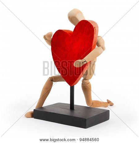 Wooden mannequin with a big heart - isolated on white background poster