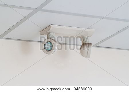 emergency lights with two lamps on the ceiling poster