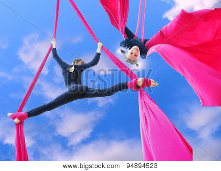 Cheerful Children Training On Aerial Silks In The Sky