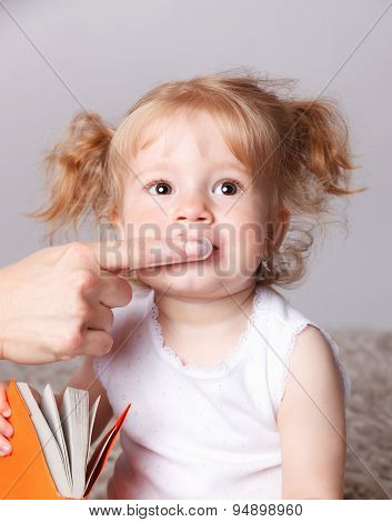 Sweet Toddler Getting Her Teeth Brushed With Finger Tooth Brush